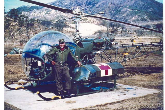 Capt. John W. Hammett poses with one of the Bell H-13 helicopters the solopilots used to move patients injured in Korea. Hammett was commander of the 49th Medical Detachment during the Korean conflict.