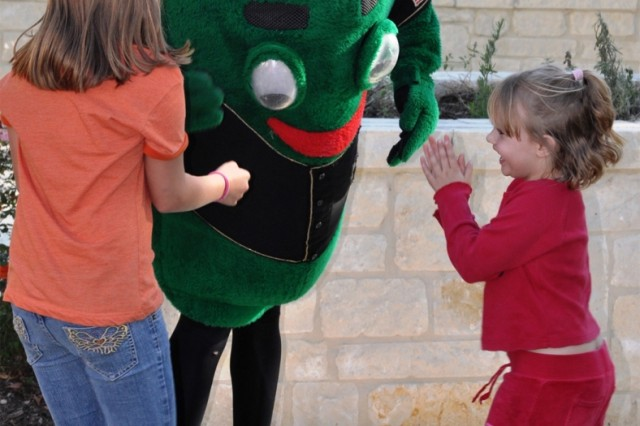 The San Antonio Missions mascot, BallapeAfA+-o, entertains Family members at the barbecue April 8 at the Warrior and Family Support Center at Fort Sam Houston, Texas.