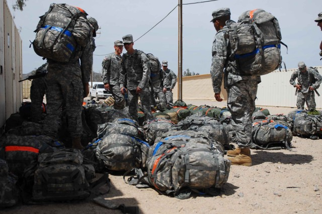 Vanguard Soldiers gather their bags and prepare to settle into their temporary living quarters at FOB Ruba at the National Training Center at Fort Irwin, Calif., April 11.