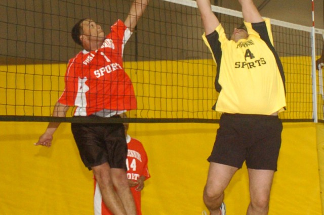 Corey Shaffer, right, hits the ball in a post intramural volleyball game in 2009.  Shaffer played and coached on post for three years.