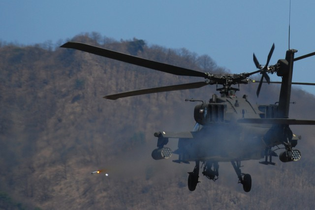 """An AH-64 Apache helicopter launches a missile at the """"enemy"""" during a Combined Arms Live Fire Exercise conducted April 15 at Rodriguez Range."""