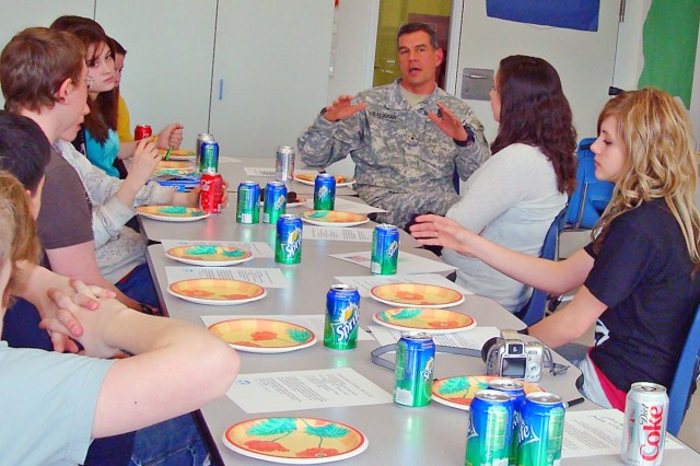 """Joint Multinational Training Command's Brig. Gen. Steven Salazar discusses leadership tactics with students from Netzaberg Middle School's Emerging Leaders group during lunch. The students also shared leadership techniques they learned from other community leaders."""""""