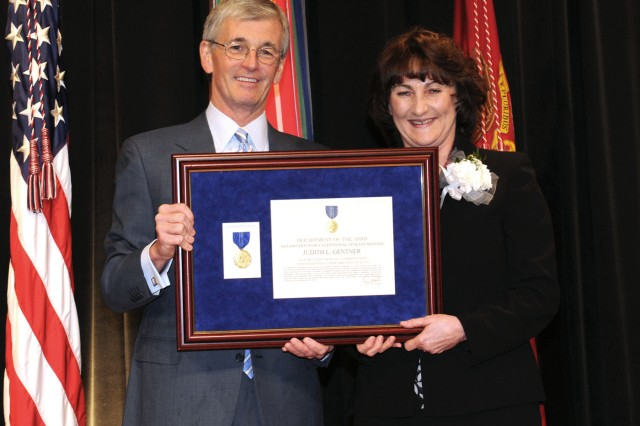 Army Secretary John McHugh presents the Decoration for Exceptional Civilian Service to Judith L. Gentner, deputy to the Fort Drum garrison commander, during a ceremony Wednesday at the Pentagon. Gentner's ability to consistently leverage private sector capabilities to augment the garrison has fundamentally improved the quality of life for Fort Drum Soldiers and Families.