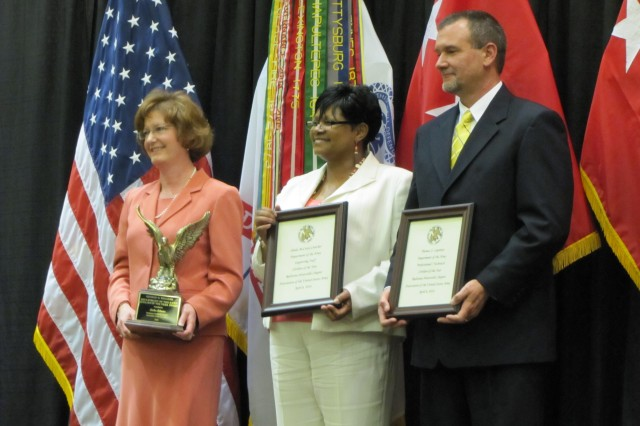 """Lisha Adams, Sheila McCrary-Crutcher and Thomas Lapointe are honored by the Redstone-Huntsville Chapter of the Association of the U.S. Army during the DA Civilian of the Year awards dinner April 6. Adams was the winning nominee in the Management/Executive category; McCrary-Crutcher in the Supporting Staff category and Lapointe in the Professional/Technical category. Adams went on to also win top DA Civilian of the Year."""""""