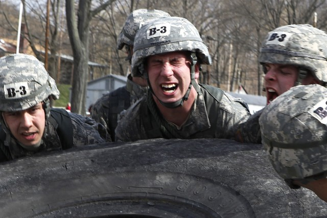West Point cadets from Company B-3 strain under the weight of a massive tire, which they struggled to move to complete one obstacle during the annual Sandhurst Competition.