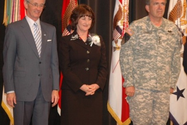"From left: Secretary of the Army John McHugh; Judith Gentner, deputy garrison commander for U.S. Army Garrison, Fort Drum, N.Y.;  and Army Vice Chief of Staff Gen. Peter Chiarelli at a Pentagon awards ceremony Wednesday. Gentner received accolades for ""tirelessly"" working to improve services at the garrison for Soldiers and families."