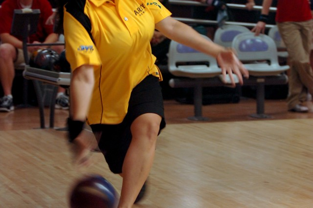 Army Team member Jiovanna Morley, a Makakilo, Hawaii resident, hurls her bowling ball down the lane during the singles competition of the All-Services Bowling Tournament held at the Bowling Center at Schofield Barracks, Hawaii, April 8. Morley, a military spouse and the daughter of a retired Soldier, will compete this June during the Hawaii TV Bowling League, an inter-island bowling competition.