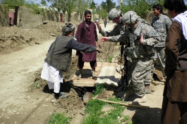 Soldiers Assist Locals in Meymaneh