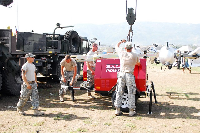 Members of U.S. Army South assist with Security Lights at IDP Camps