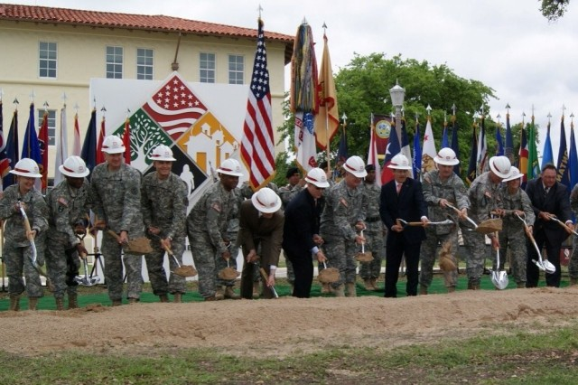 Members of the Installation Management Command headquarters groundbreaking party toss the first shovel of dirt.
