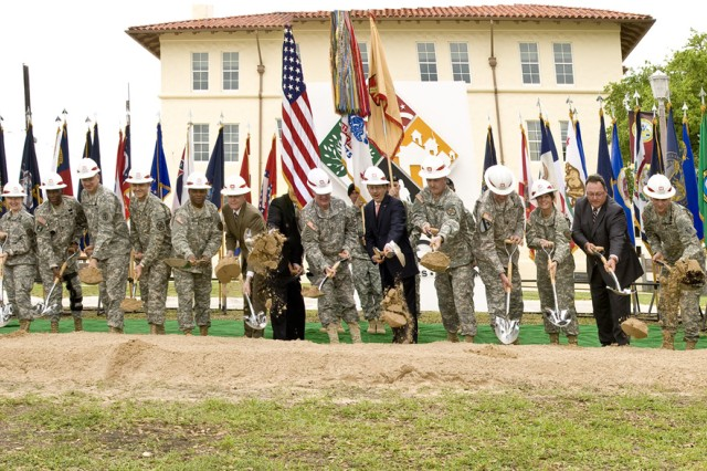 Members of the Installation Management Command headquarters groundbreaking party toss the first shovel of dirt