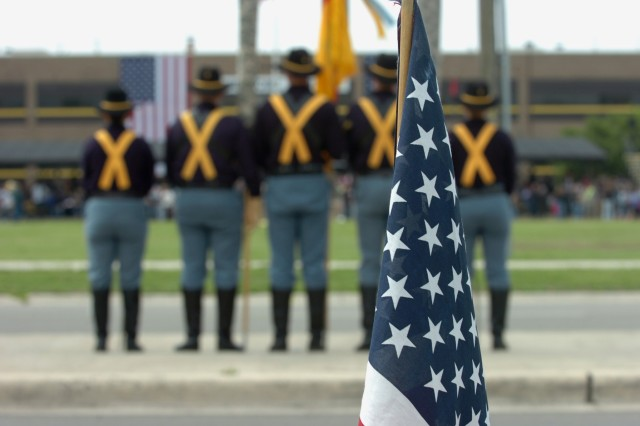 FORT HOOD, Texas-An American flag blows in the breeze, as the 1st Cavalry Division honor guard waits in front of Cooper Field, while preparing for the arrival of a group of 1st Air Cavalry Brigade Soldiers returning from Iraq, April 19.