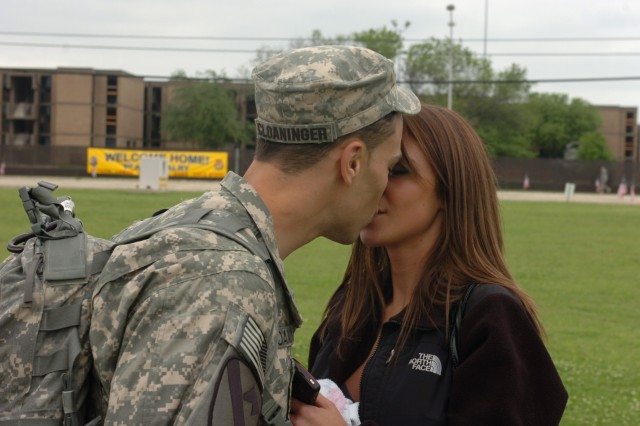 FORT HOOD, Texas-Capt. Logan Cloaninger (left), of 1st Battalion, 227th Aviation Regiment, 1st Air Cavalry Brigade, 1st Cavalry Division, greets girlfriend Christine Holder with a kiss after a welcome home ceremony at Cooper Field, April 19. Holder traveled from Charlotte, N.C. to reunite with Cloaninger, who completed a year-long deployment in support of Operation Iraqi Freedom.