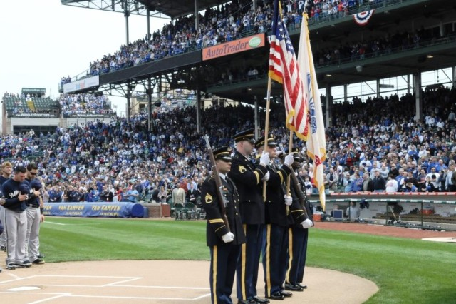 A look at some of the 43 Thousand fans at Wrigley Field, home of the Chicago Cubs, while Soldiers from the United States Army Chicago Recruiting Battalion present the nation's colors on opening day, April 12, 2010.  Pictured from left to right are, Staff Sgt. Jeremiah Delrio, Staff Sgt. Jesse Moon, Staff Sgt. William Richardson and Sgt. Darren Thurman, Glenview, Ill., Recruiting Company, Melrose Park and North Cicero Recruiting Stations.