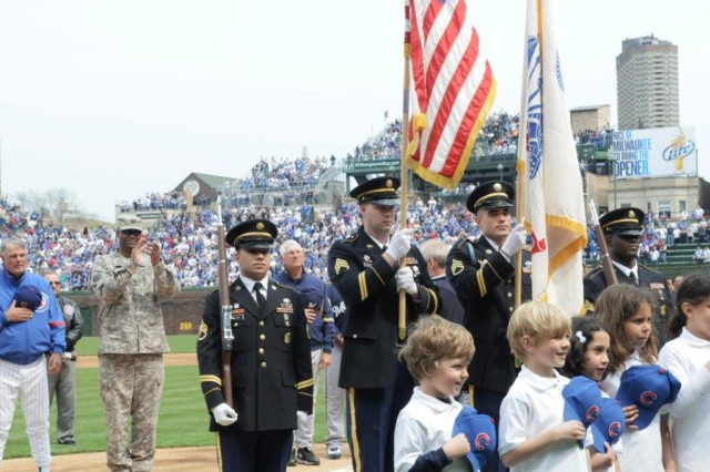 Members of the Chicago Recruiting Battalion perform official Color Guard duties for the Chicago Cubs opening day game April 12, 2010, while local grade school children recite the Pledge of Allegiance.  Pictured from left to right are, Staff Sgt. Jeremiah Delrio, Staff Sgt. Jesse Moon, Staff Sgt. William Richardson and Sgt. Darren Thurman, Glenview, Ill., Recruiting Company, Melrose Park and North Cicero Recruiting Stations.