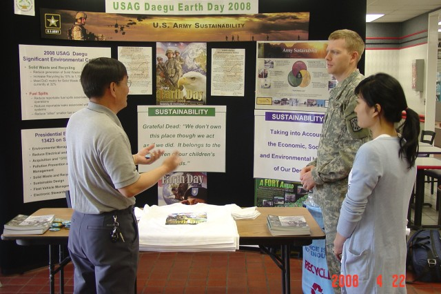 Mr. An and SGT Johnson from Armed Forces Network Korea and Ms. Kim, KyongPook National University student intern (right), discuss the 2008 Earth Day Sustainability display. Mr. Chartier sponsored numerous education and public awareness events. One of these was week-long Environmental Awareness Campaign celebrating Earth Day.