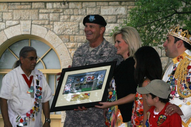FORT SAM HOUSTON, Texas - Lt. Gen. Guy Swan III, commanding general, U.S. Army North, presents a framed commemorative gift, adorned by military coins of the major units on base along with a placard, to Mary Begia, president, Fiesta San Antonio Commission, during the Army North Commanding General's reception at Army North's historic Quadrangle April 18. More than 250 invited guests attended the event and enjoyed the festivities, which featured a gift exchange, a performance by the Old Guard Fife and Drum Corps and music by the U.S. Army Medical Command Band.   (U.S. Army photo by Sgt. Maj. Eric Lobsinger, U.S. Army North PAO)