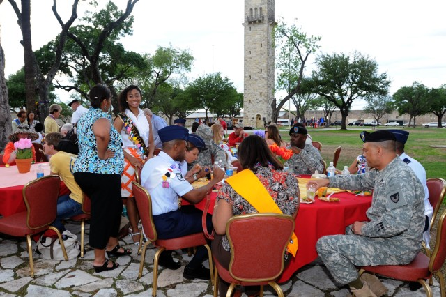 FORT SAM HOUSTON, Texas - Fort Sam Houston military and Civilian community  members, along with San Antonio Fiesta 2010 royalty and invited guests, dine on authentic Mexican food during the Army North Commanding General's reception at historic ARNORTH Quadrangle April 18.
