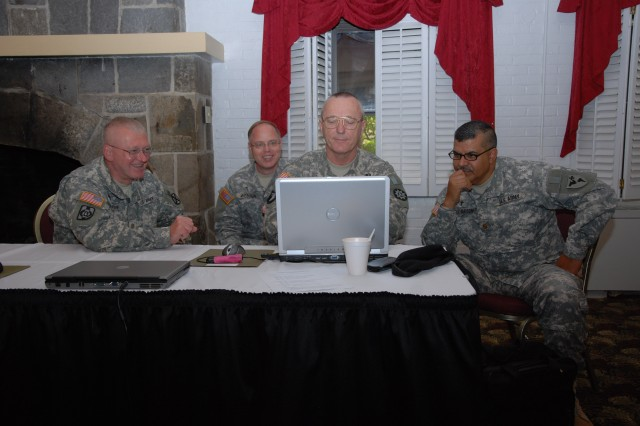 Maj. David Harsdorf (Fort Sill, Okla.); Col. Eric Wester (National Defense University, Washington, D.C.); Lt. Col. Donald Eubank (Fort Eustis, Va.); and Maj. Pablo Perez-Maisonet (Fort Benning, Ga.) brainstorm ways for the chaplaincy to partner with the Army Center for Excellence for the Professional Military Ethic during the TRADOC Chaplain Service School Instructors Development Training from Apr. 13 to 15 at the Bay Breeze Community Center at Fort Monroe, Va.
