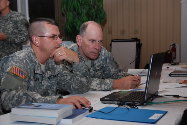 Maj. Jeff Spangler (Soldier Support Institute at Fort Jackson, S.C.) and Maj. John Rasmussen (Fort Huachuca, Ariz,) brainstorm ways for the chaplaincy to partner with the Army Center for Excellence for the Professional Military Ethic during the TRADOC Chaplain Service School Instructors Development Training from Apr. 13 to 15 at the Bay Breeze Community Center at Fort Monroe, Va.
