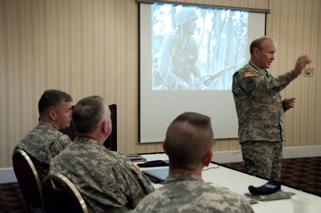 Gen. Martin E. Dempsey, commanding general of U.S. Army Training and Doctrine Command, addresses the instructors of the Chaplain Service School during their development training on Fort Monroe, Va., April 13, 2010. The group was tasked to discuss ethics and morality in the force. Photo Credit Sgt. Angelica Golindano