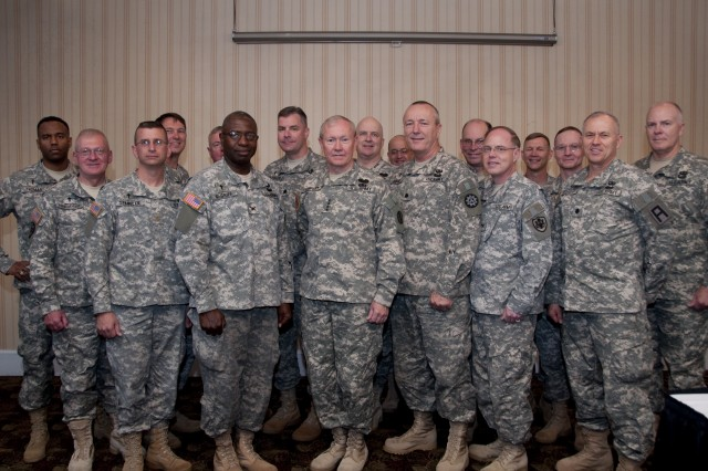 Gen. Martin E. Dempsey, commanding general of U.S. Army Training and Doctrine Command, takes a group photo with the instructors of the Chaplain Service School during their development training on Fort Monroe, Va., April 13, 2010. The group was tasked to discuss ethics and morality in the force.  Photo Credit Sgt. Angelica Golindano
