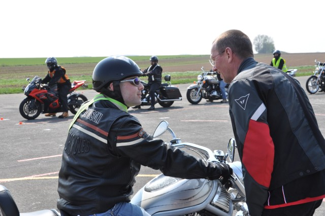 Detlev Mahlstaede (right), a rider coach based in Germany for the Motorcycle Safety Foundation, gives Sgt. Michael Lynch, USAG Benelux military policeman, instant feedback on his performance April 15. Lynch was one of 12 participants in the two-day Basic Riders Course.