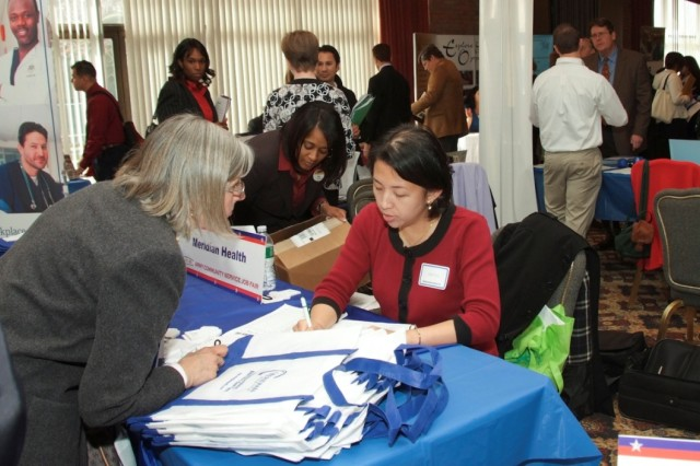 Job seekers and employers made their best sales pitches to each other during a recent job fair at Fort Monmouth.