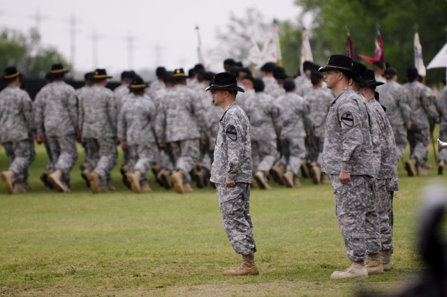 FORT HOOD, Texas-Col. Douglas Crissman (center), the new commander for 3rd Brigade Combat Team, 1st Cavalry Division,  conducts a review of his passing Soldiers during the brigade's change of command ceremony, April 16, on Cooper Field at Fort Hood.