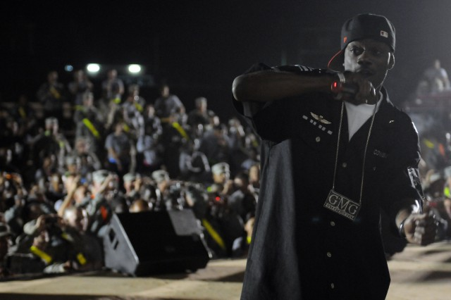 Rap-recording artist and Chicago native B-Hype performs with Twista at a show for the troops in the outdoor theater here April 14 on the second stop of a five-stop tour. (U.S. Army photo by Staff Sgt. Matthew C. Cooley, 15th Sustainment Brigade public affairs)