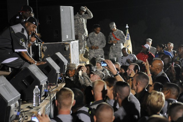 Rap-recording artists and Chicago natives Twista and B-Hype perform for service members at a show for the troops in the outdoor theater here April 14 on the second stop of a five-stop tour. (U.S. Army photo by Staff Sgt. Matthew C. Cooley, 15th Sustainment Brigade public affairs)