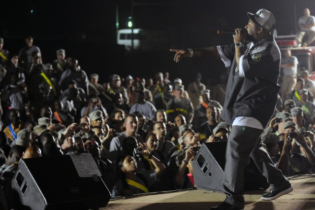 Rap-recording artist and Chicago native Twista performs for service members at a show for the troops in the outdoor theater here April 14 on the second stop of a five-stop tour. (U.S. Army photo by Staff Sgt. Matthew C. Cooley, 15th Sustainment Brigade public affairs)