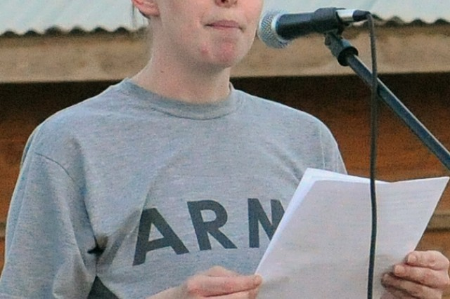 Pvt. Megan Moffatt, a College Station, Texas native and mayor-cell help desk clerk for 15th Special Troops Battalion, 15th Sustainment Brigade, 13th Sustainment Command (Expeditionary), reads her award-winning essay before a 5 kilometer walk to raise awareness of sexual assault here April 16. (U.S. Army photo by Staff Sgt. Matthew C. Cooley, 15th Sustainment Brigade public affairs)