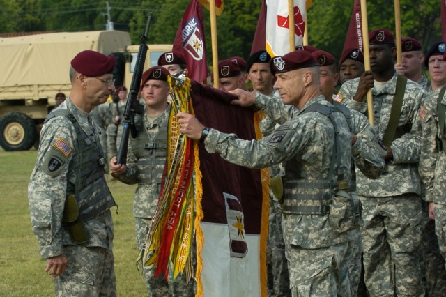 FORT BRAGG, N.C. - Col. Ronald A. Maul, the final commander of the 44th Medical Command, uncases the unit's new colors, with the assistance of Lt. Gen. Frank G. Helmick, commanding general, XVIII Airborne Corps and Fort Bragg, as it is reactivated as the 44th Medical Brigade. The 44th MEDCOM was deactivated after ten years of service as a command and reverted back to the 44th Medical Brigade April 21. (U.S. Army photo by Spc. A.M. LaVey / XVIII Airborne Corps)