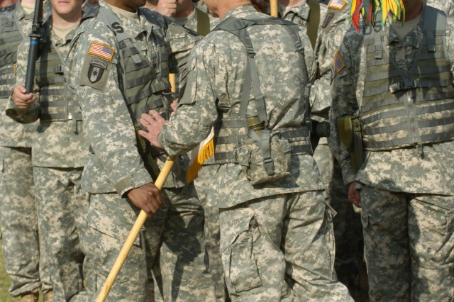 FORT BRAGG, N.C. -- Col. Donald R. West, the incoming commander of the 44th Medical Brigade, accepts the colors of the brigade from Lt. Gen. Frank G. Helmick, commanding general, XVIII Airborne Corps and Fort Bragg. This is not West's first time at the 44th, he commanded the 86th Combat Support Hospital, a subordinate unit, during Operation Iraqi Freedom. (U.S. Army photo by Spc. A.M. LaVey / XVIII Airborne Corps)