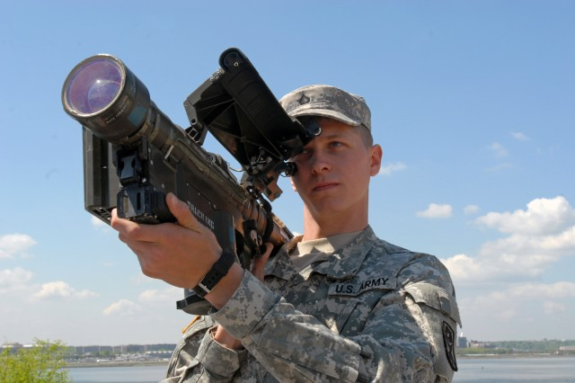 Pfc. Trevor Gaston, a Soldier with the 2nd Battalion, 263rd Air Defense Artillery, demonstrates an FIM-92 Stinger MANPADS (Man-Portable Air-Defense System) at Bolling Air Force Base, April 14, 2010. Air Defense units from South Carolina and Ohio have been on rotating deployments to the National Capitol Region to support homeland defense as part of Operation Noble Eagle. This continued operation began in 2001, just days after--and in response to--the 9/11 terrorist attacks.