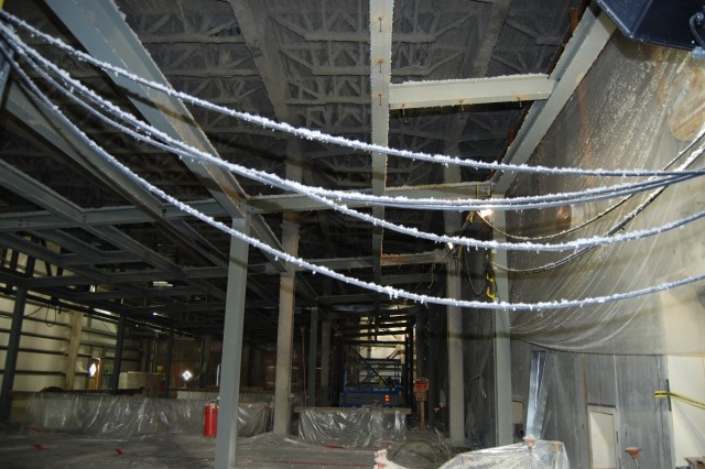 Structural steel fire proofing is currently taking place inside the Enhanced Reconfiguration Building near the Explosion Containment Rooms (right).