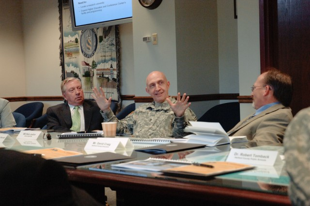 Aberdeen Proving Ground Installation Commanding General Maj. Gen. Nick Justice (center), his executive deputy,Gary Martin (right), and Harford Community College President James LaCalle (left) discuss regional transformation with county officials April 16 at the garrison headquarters.