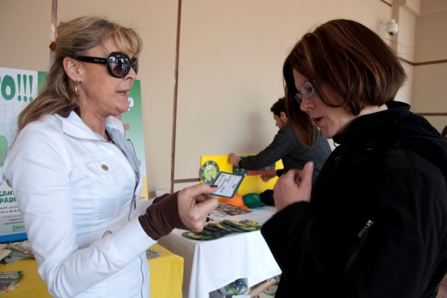 (Left to right) Rosanna Barbafieri from AAMPS Livorno  explains to Janine Wick the exact procedure for large waste disposal during Earth Day celebrations at Camp Darby, April 22.