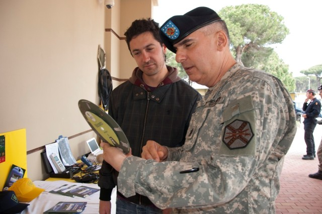 "(Left to right) Francesco Cambioni from GEOFOR Pisa explains to U.S. Army Garrison Livorno Command Sgt. Maj. Felix Rodriguez the use of the ""rifiutometro"", by selecting the image of what needs to be disposed it will show the exact  disposing procedures for that specific item. GEOFOR joined the Camp Darby Community in celebrating Earth Day April 22."