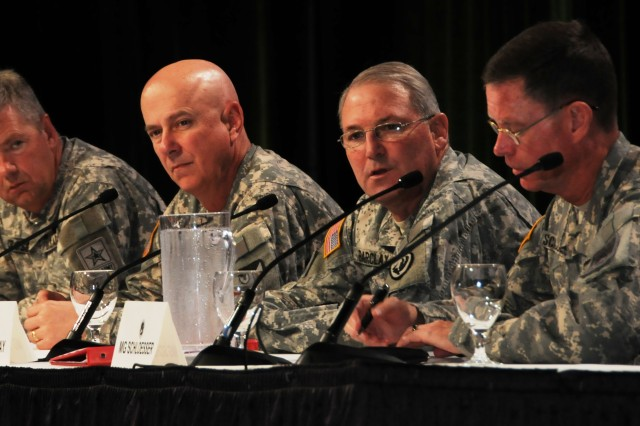 From right, Maj. Gen. Jeffrey J. Schloesser, director, Army Aviation; Maj. Gen. James O. Barclay III, commanding general, U.S. Army Aviation Center of Excellence; Maj. Gen. James R. Myles, commanding general, AMCOM; and Brig. Gen. William T. Crosby, PEO Aviation, conduct a professional session during the April 15-17 Army Aviation Association of America convention in Fort Worth, Texas.