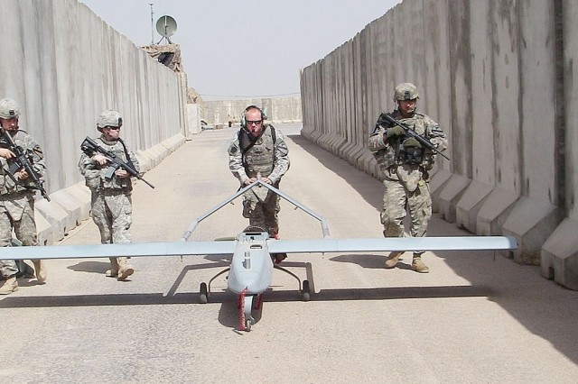 Soldiers assigned to the 4th Special Troops Bn., 4th BCT, 1st Cav. Div., UAS Platoon, move to a UAS launch and recovery site on Forward Operating Base Hunter, Iraq, recently.