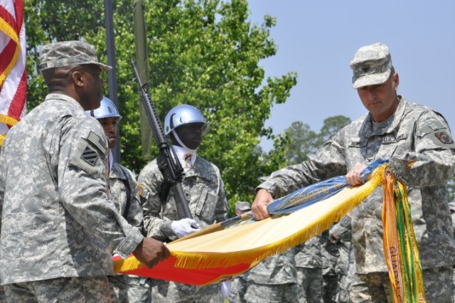 The 3rd Sustainment Bde. commander, Col. Shawn M. Morrissey cases the Brigade colors with the assistance of Command Sgt. Maj. Clifton Johnson at Marne Garden at Fort Stewart, April 15.