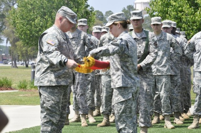 The 3rd Sustainment Bde. Special Troops Battalion command team, Lt. Col. Heidi J. Hoyle, commander, and Command Sgt. Maj. Anthony D. Whitney, case the battalion Colors at Marne Garden in preparation for deployment to Iraq, April 15.