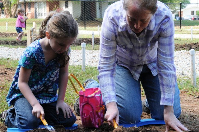 Meredith Weipert and her daughter, Alexis, 6, prepare their Family plot in the Fort Rucker Community Garden April 15.