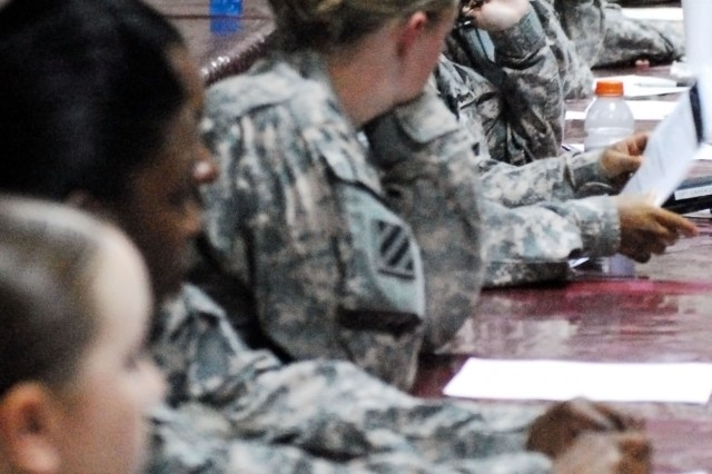 Task Force Marne Soldiers watch a video about sexual assault during Sexual Assault Awareness Training at Contingency Operating Base Speicher, Iraq, April 15.