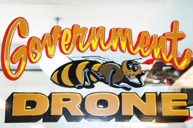 """One of Lee Jensen's signs - """"Government Drone,"""" painted on the door of one of the offices in the First Powerhouse."""