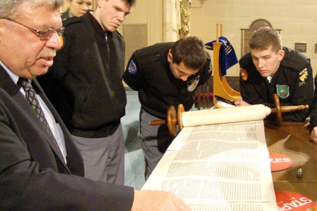 Firsties Kyle Staron, Matt Archuleta and Porter Smith look on as Rabbi Ken Brickman reads from the Torah in a Jersey City synagogue.