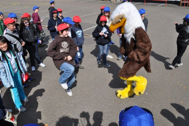 RockinAca,!a,,c and rollinAca,!a,,c Students participating in USAG SchinnenAca,!a,,cs Earth Day 2010 activities pause to dance with the American Forces Network Eagle, a special guest made possible by AFNAca,!a,,cs live coverage of the event April 22.