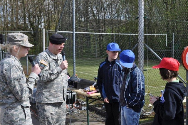 AFN and their live radio remote  American Forces Network radio operated a live radio remote broadcast from the USAG Schinnen Pavilion during Earth Day 2010 activities held there April 22. Here, three students representing Canada, Denmark and the United Kingdom tell listeners throughout the AFN Benelux footprint about how to protect the environment. Moe than 250 students representing at least 12 nations participated in a day of fun, learning and discovery.